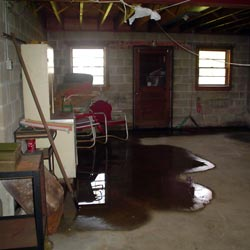 A flooded basement showing groundwater intrusion in [[custom_tbf_major_city_1]]