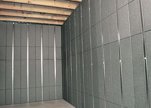 SilverGlo™ insulation and metal studs making up our Basement to Beautiful™ panels