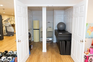TBF finished basement with home gym in [[custom_tbf_major_city_1]]